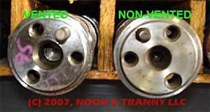Vented optisparks have a deep centering hole in the camshaft and a longer dowel pin (left photo)